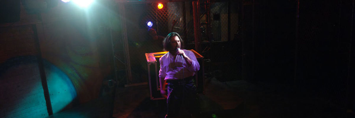 Ensemble member Carmine Grisolia sings in Tooth of Crime.